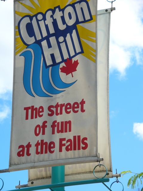 Large pole banner the says Clifton Hill: The street of fun at the Falls