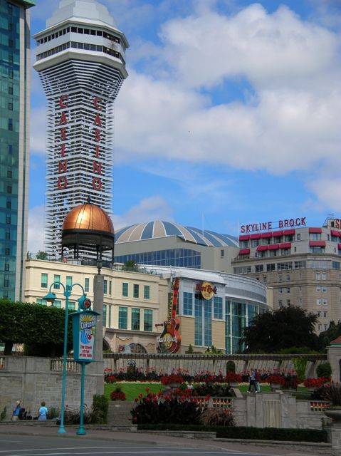 Several buildings and a high tower with Casino in red letters down it.