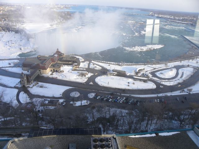 A winter aerial view of Table Rock Welcome Centre, parking lot, and other roads surrounding it.